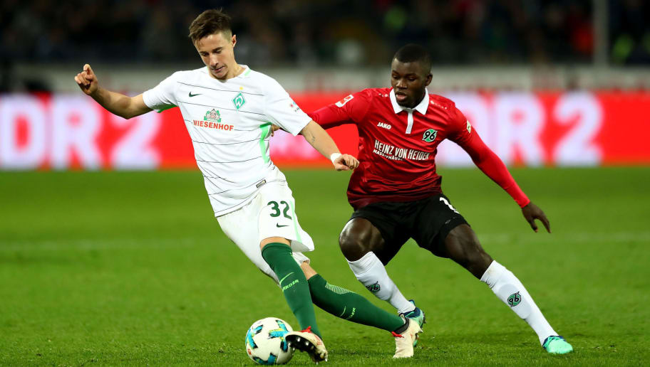 HANOVER, GERMANY - APRIL 06: Ihlas Bebou (R) of Hannover and Marco Friedl of Bremen battle for the ball during the Bundesliga match between Hannover 96 and SV Werder Bremen at HDI-Arena on April 6, 2018 in Hanover, Germany.  (Photo by Martin Rose/Bongarts/Getty Images)
