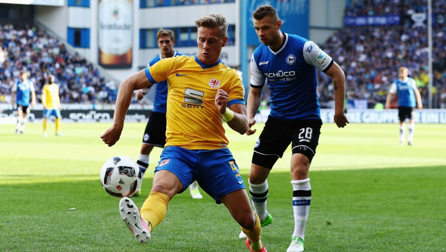 BIELEFELD, GERMANY - MAY 14:  Julius Biada (L) of Braunschweig in action during the Second Bundesliga match between DSC Arminia Bielefeld and Eintracht Braunschweig at Schueco Arena on May 14, 2017 in Bielefeld, Germany.  (Photo by Oliver Hardt/Bongarts/Getty Images)