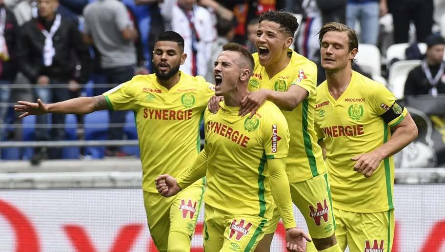 Nantes' French midfielder Valentin Rongier (C) celebrates with teammates after scoring a goal during the French L1 football match between Lyon and Nantes at the Parc Olympique Lyonnais stadium in Decines-Charpieu near Lyon, southeastern France, on May 7, 2017. / AFP PHOTO / PHILIPPE DESMAZES        (Photo credit should read PHILIPPE DESMAZES/AFP/Getty Images)