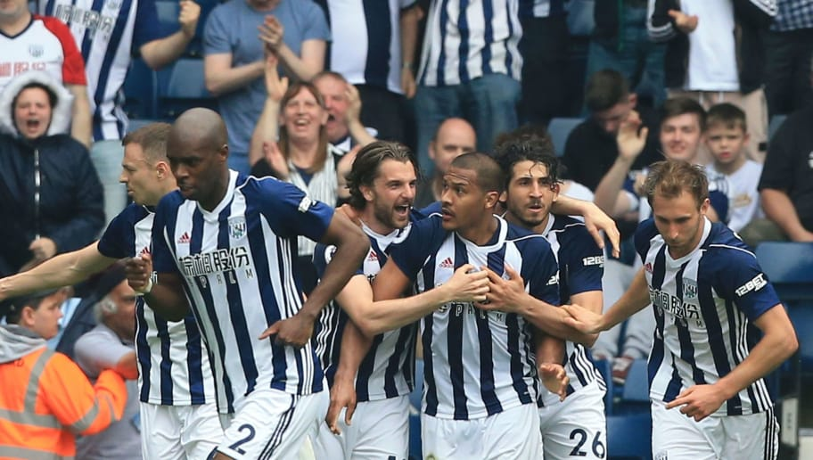 West Bromwich Albion's Venezuelan striker Salomon Rondon (C) celebrates with his team-mates after scoring their second goal to equalise 2-2 during the English Premier League football match between West Bromwich Albion and Liverpool at The Hawthorns stadium in West Bromwich, central England, on April 21, 2018. (Photo by Lindsey PARNABY / AFP) / RESTRICTED TO EDITORIAL USE. No use with unauthorized audio, video, data, fixture lists, club/league logos or 'live' services. Online in-match use limited to 75 images, no video emulation. No use in betting, games or single club/league/player publications. /         (Photo credit should read LINDSEY PARNABY/AFP/Getty Images)
