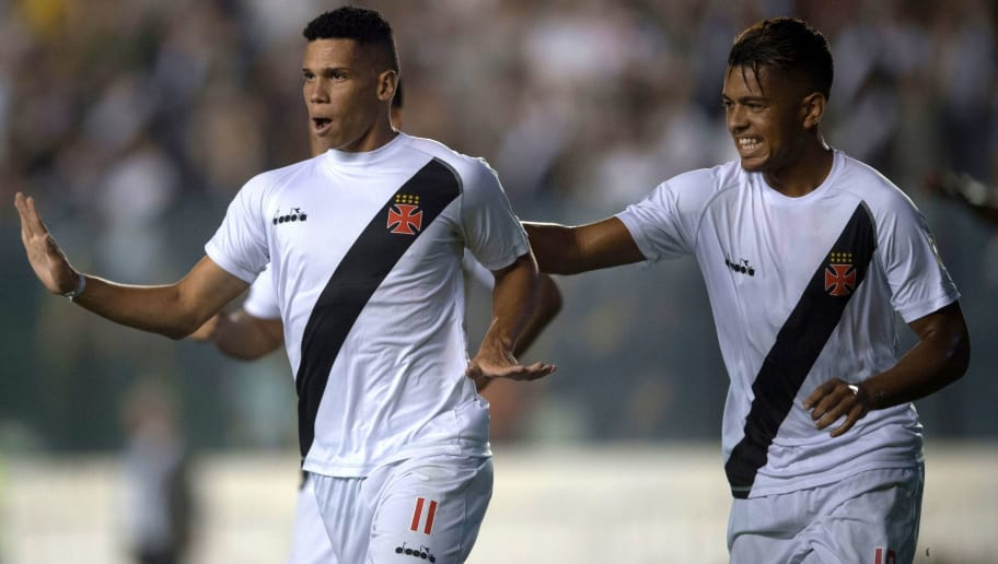 Brazil's Vasco da Gama player Paulinho (L) celebrates with his teammates after scoring a goal against Chile's Universidad Concepcion during their 2018 Libertadores Tournament match at Sao Januario stadium in Rio de Janeiro, Brazil, on February 7, 2018.   / AFP PHOTO / MAURO PIMENTEL        (Photo credit should read MAURO PIMENTEL/AFP/Getty Images)