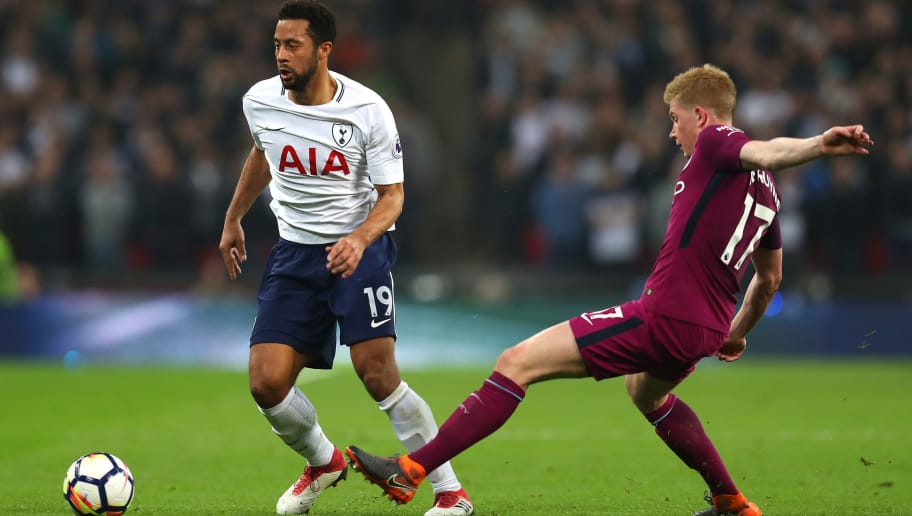 LONDON, ENGLAND - APRIL 14: Mousa Dembele of Tottenham Hotspur is challenged by Kevin De Bruyne of Manchester City during the Premier League match between Tottenham Hotspur and Manchester City at Wembley Stadium on April 14, 2018 in London, England.  (Photo by Catherine Ivill/Getty Images)