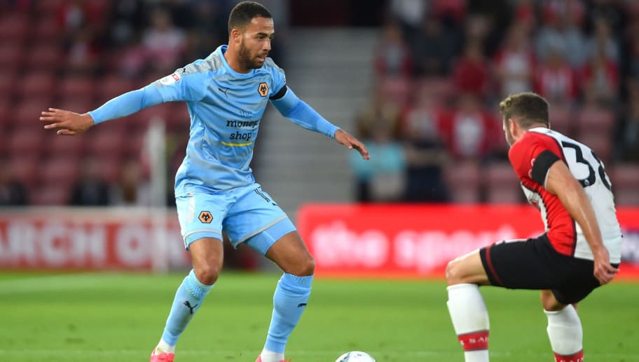 SOUTHAMPTON, ENGLAND - AUGUST 23: Jordan Graham of Wolverhampton Wanderers attempts to get past Sam McQueen of Southampton during the Carabao Cup Second Round match between Southampton and Wolverhampton Wanderers at St Mary's Stadium on August 23, 2017 in Southampton, England.  (Photo by Mike Hewitt/Getty Images)