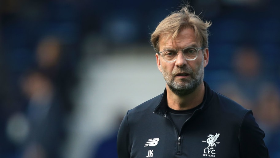 Liverpool's German manager Jurgen Klopp watches his players warm-up before kick off of the English Premier League football match between West Bromwich Albion and Liverpool at The Hawthorns stadium in West Bromwich, central England, on April 21, 2018. (Photo by Lindsey PARNABY / AFP) / RESTRICTED TO EDITORIAL USE. No use with unauthorized audio, video, data, fixture lists, club/league logos or 'live' services. Online in-match use limited to 75 images, no video emulation. No use in betting, games or single club/league/player publications. /         (Photo credit should read LINDSEY PARNABY/AFP/Getty Images)