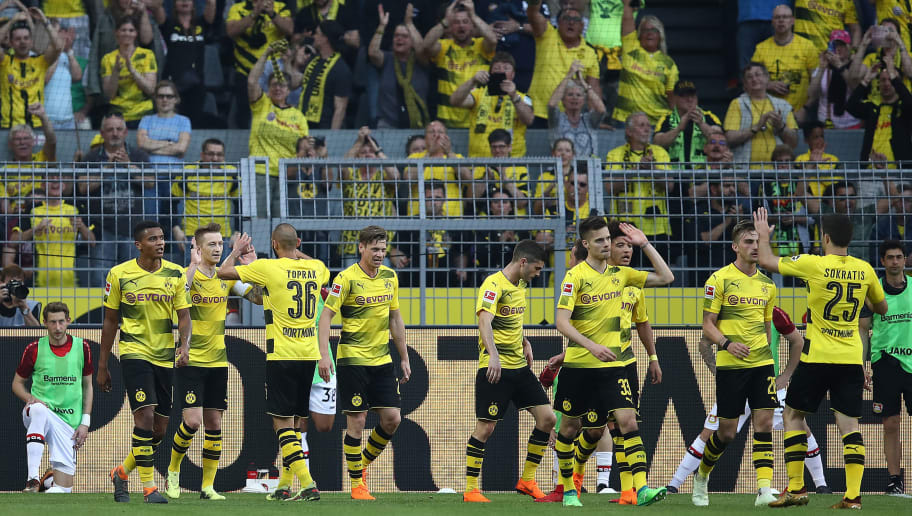 DORTMUND, GERMANY - APRIL 21: Marco Reus of Dortmund (2nd left) celebrates with his team after he scored a goal to make it 2:0 during the Bundesliga match between Borussia Dortmund and Bayer 04 Leverkusen at Signal Iduna Park on April 21, 2018 in Dortmund, Germany. (Photo by Maja Hitij/Bongarts/Getty Images)