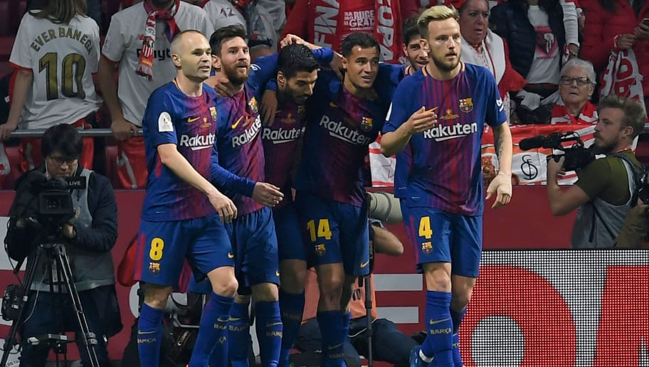 Barcelona's Uruguayan forward Luis Suarez (3L) celebrates with teammates after scoring during the Spanish Copa del Rey (King's Cup) final football match Sevilla FC against FC Barcelona at the Wanda Metropolitano stadium in Madrid on April 21, 2018. (Photo by LLUIS GENE / AFP)        (Photo credit should read LLUIS GENE/AFP/Getty Images)