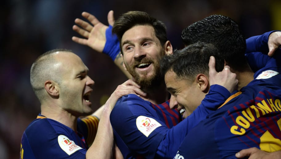 Barcelona's Uruguayan forward Luis Suarez (R) celebrates with Barcelona's Spanish midfielder Andres Iniesta, Barcelona's Argentinian forward Lionel Messi and Barcelona's Brazilian midfielder Philippe Coutinho after scoring during the Spanish Copa del Rey (King's Cup) final football match Sevilla FC against FC Barcelona at the Wanda Metropolitano stadium in Madrid on April 21, 2018. (Photo by CRISTINA QUICLER / AFP)        (Photo credit should read CRISTINA QUICLER/AFP/Getty Images)