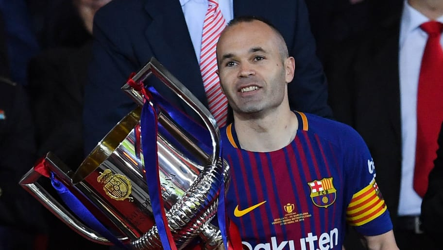 BARCELONA, SPAIN - APRIL 21:  Andres Iniesta of FC Barcelona lifts the trophy after winning with his team the Spanish Copa del Rey Final match between Barcelona and Sevilla at Wanda Metropolitano stadium on April 21, 2018 in Barcelona, Spain.  (Photo by David Ramos/Getty Images)