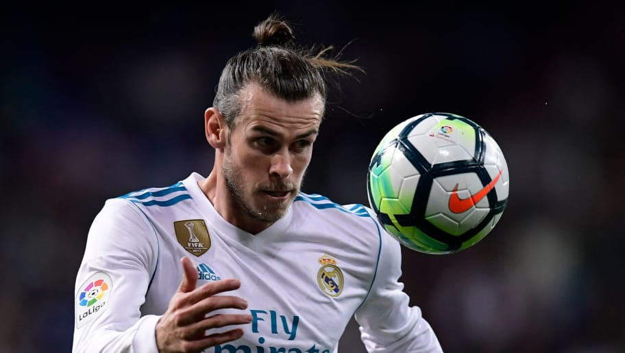 Real Madrid's Welsh forward Gareth Bale eyes the ball during the Spanish league football match Real Madrid CF against Athletic Club Bilbao at the Santiago Bernabeu stadium in adrid on April 18, 2018. / AFP PHOTO / JAVIER SORIANO        (Photo credit should read JAVIER SORIANO/AFP/Getty Images)