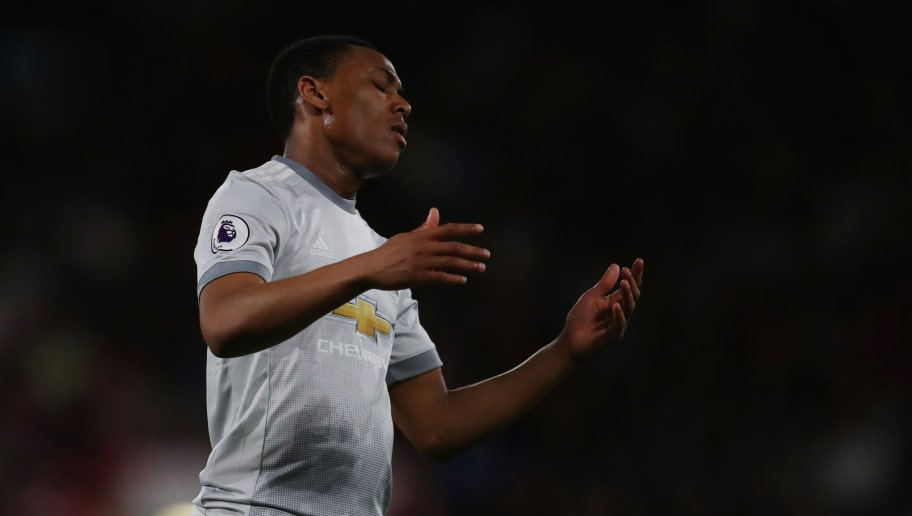 BOURNEMOUTH, ENGLAND - APRIL 18: Anthony Martial of Manchester United reacts during the Premier League match between AFC Bournemouth and Manchester United at Vitality Stadium on April 18, 2018 in Bournemouth, England. (Photo by Catherine Ivill/Getty Images)