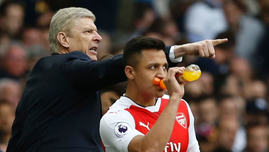 Arsenal's French manager Arsene Wenger (L) gestures alongside Arsenal's Chilean striker Alexis Sanchez during the English Premier League football match between Tottenham Hotspur and Arsenal at White Hart Lane in London, on April 30, 2017.  / AFP PHOTO / IKIMAGES / Ian KINGTON / RESTRICTED TO EDITORIAL USE. No use with unauthorized audio, video, data, fixture lists, club/league logos or 'live' services. Online in-match use limited to 75 images, no video emulation. No use in betting, games or single club/league/player publications.  /         (Photo credit should read IAN KINGTON/AFP/Getty Images)