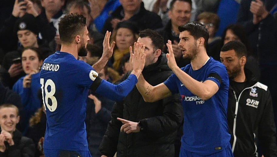Chelsea's French attacker Olivier Giroud (L) high-fives his replacement Chelsea's Spanish striker Alvaro Morata (R) as he goes off as a substitute during the English Premier League football match between Chelsea and Crystal Palace at Stamford Bridge in London on March 10, 2018. / AFP PHOTO / Glyn KIRK / RESTRICTED TO EDITORIAL USE. No use with unauthorized audio, video, data, fixture lists, club/league logos or 'live' services. Online in-match use limited to 75 images, no video emulation. No use in betting, games or single club/league/player publications.  /         (Photo credit should read GLYN KIRK/AFP/Getty Images)