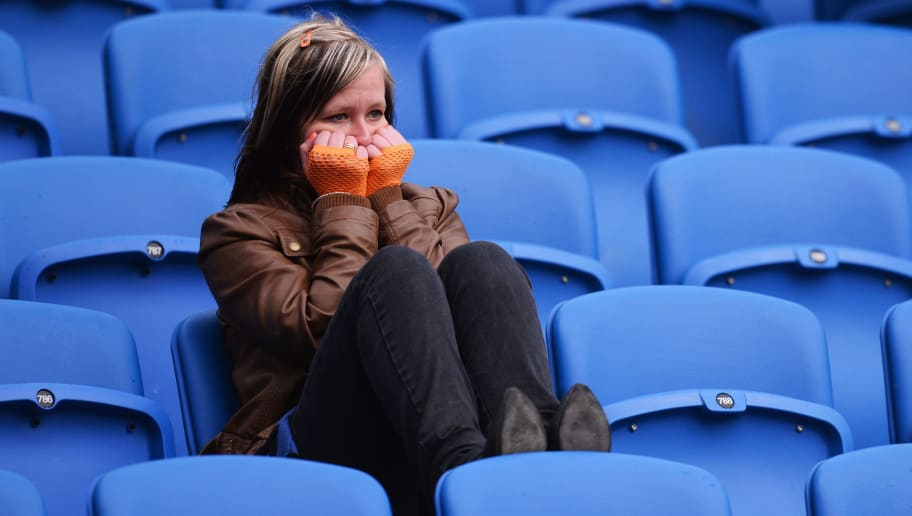 BRIGHTON, ENGLAND - MAY 04:  A Wolverhampton Wanderers fan looks dejected as her team are relegated after the npower Championship match between Brighton & Hove Albion and Wolverhampton Wanderers at Amex Stadium on May 4, 2013 in Brighton, England.  (Photo by Mike Hewitt/Getty Images)