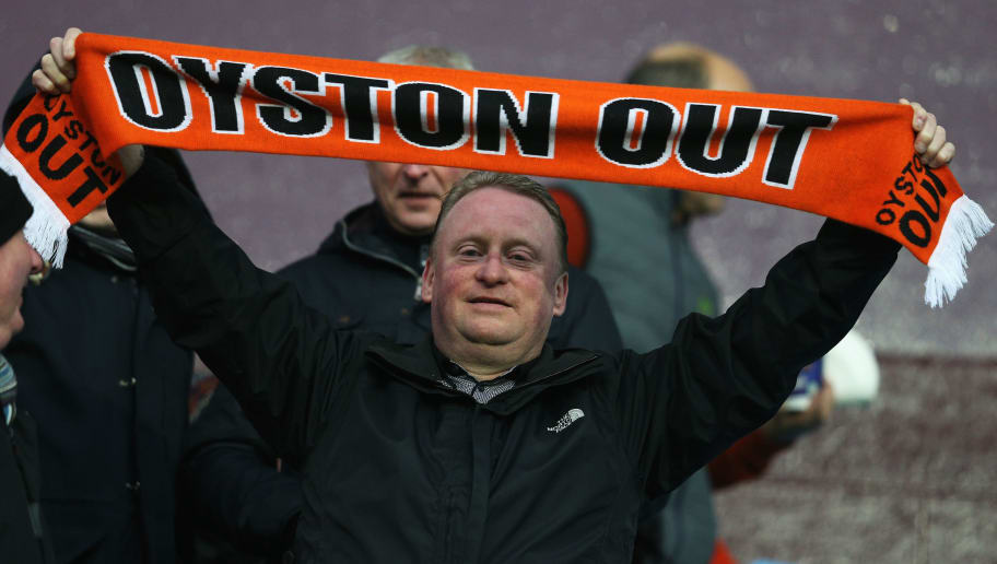 BIRMINGHAM, ENGLAND - JANUARY 04: A Blackpool fan displays a message for Chairman Karl Oyston during the FA Cup Third Round match between Aston Villa and Blackpool at Villa Park on January 4, 2015 in Birmingham, England.  (Photo by Clive Mason/Getty Images)
