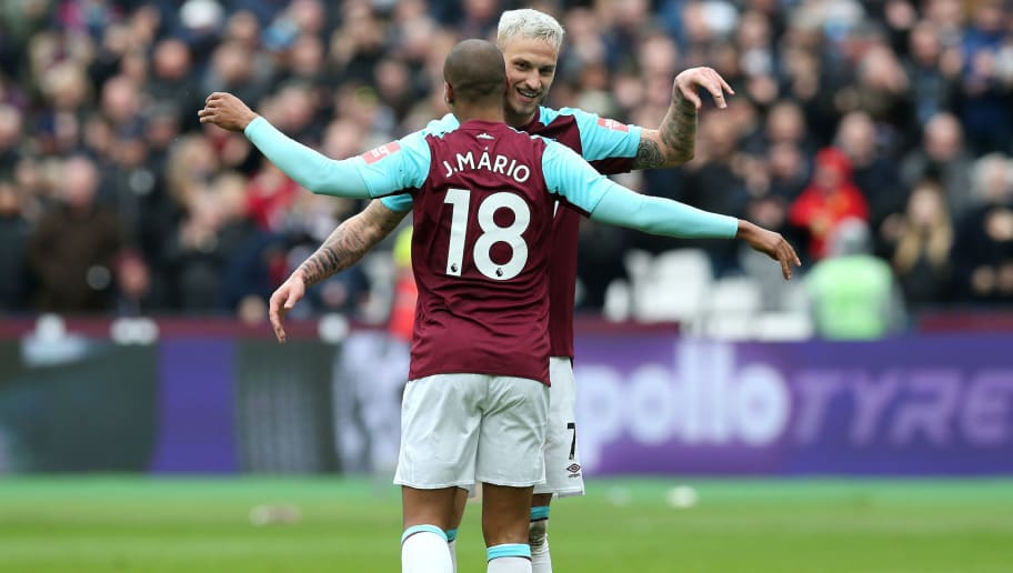 LONDON, ENGLAND - MARCH 31:  Marko Arnautovic of West Ham United celebrates with teammate Joao Mario after scoring his sides second goal during the Premier League match between West Ham United and Southampton at London Stadium on March 31, 2018 in London, England.  (Photo by Alex Morton/Getty Images)