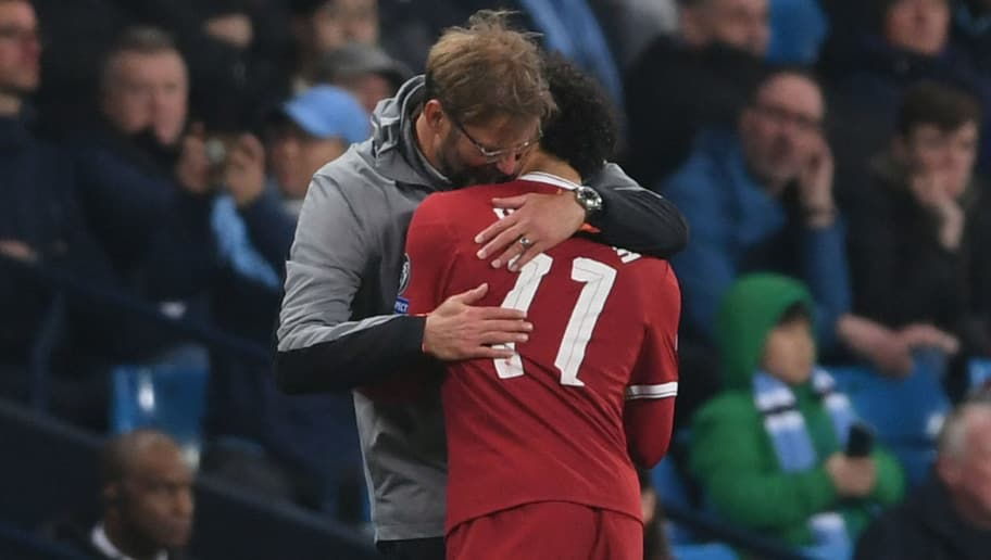 MANCHESTER, ENGLAND - APRIL 10:  Mohamed Salah of Liverpool embraces Jurgen Klopp, Manager of Liverpool as he is substituted off during the UEFA Champions League Quarter Final Second Leg match between Manchester City and Liverpool at Etihad Stadium on April 10, 2018 in Manchester, England.  (Photo by Laurence Griffiths/Getty Images,)
