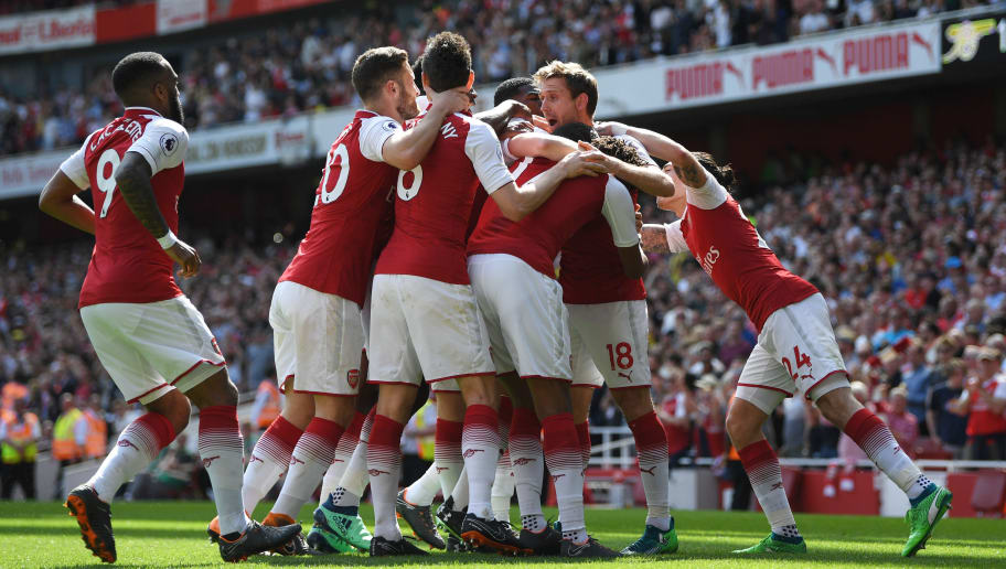 LONDON, ENGLAND - APRIL 22:  Nacho Monreal of Arsenal celebrates scoring his side's first goal with team mates during the Premier League match between Arsenal and West Ham United at Emirates Stadium on April 22, 2018 in London, England.  (Photo by Shaun Botterill/Getty Images)