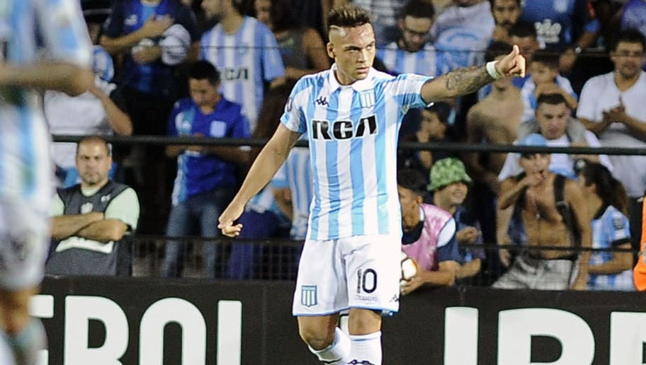 Argentina's Racing Club forward Lautaro Martinez, celebrates after scoring against Brazil's Vasco da Gama, during the Copa Libertadores group E football match, at Presidente Peron stadium in Avellaneda, Buenos Aires on April 19, 2018. (Photo by JAVIER GONZALEZ TOLEDO / AFP)        (Photo credit should read JAVIER GONZALEZ TOLEDO/AFP/Getty Images)