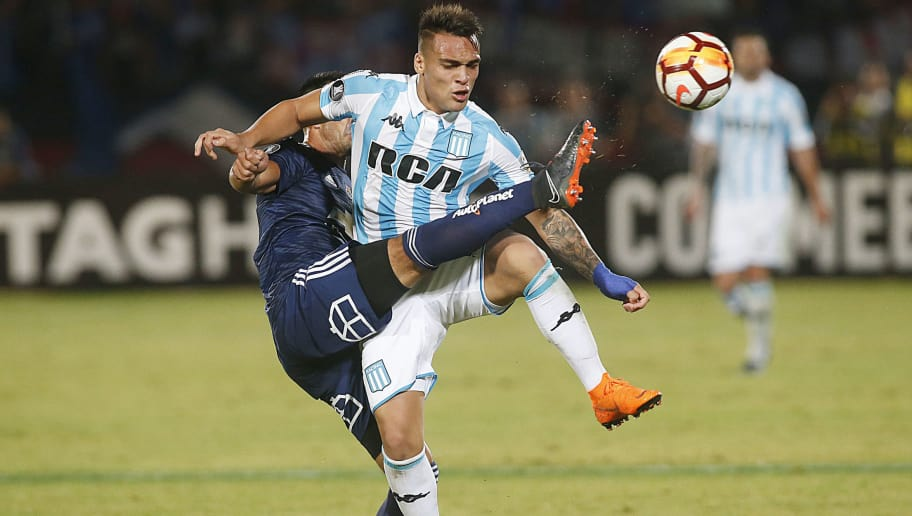 SANTIAGO, CHILE - APRIL 03: Christian Vilches of U de Chile fights for the ball with Lautaro Martinez of Racing Club during a match between U de Chile and Racing Club as part of Copa CONMEBOL Libertadores 2018 Group E at Nacional Julio Martinez Pradanos Stadium on April 03, 2018 in Santiago, Chile. (Photo by Esteban Garay/Getty Images)