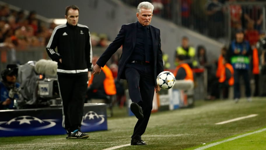 Bayern Munich's German head coach Jupp Heynckes kicks the ball from the side of the pitch during the UEFA Champions League quarter-final second leg football match between Bayern Munich and Sevilla FC on April 11, 2018 in Munich, southern Germany.  / AFP PHOTO / Odd ANDERSEN        (Photo credit should read ODD ANDERSEN/AFP/Getty Images)