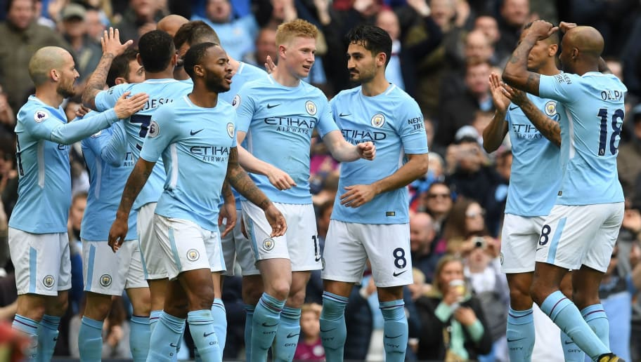 Manchester City's Belgian midfielder Kevin De Bruyne (C) celebrates scoring their third goal during the English Premier League football match between Manchester City and Swansea at the Etihad Stadium in Manchester, north west England, on April 22, 2018. (Photo by Paul ELLIS / AFP) / RESTRICTED TO EDITORIAL USE. No use with unauthorized audio, video, data, fixture lists, club/league logos or 'live' services. Online in-match use limited to 75 images, no video emulation. No use in betting, games or single club/league/player publications. /         (Photo credit should read PAUL ELLIS/AFP/Getty Images)