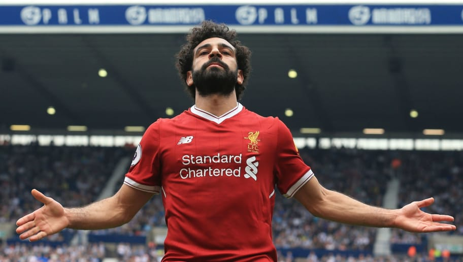Liverpool's Egyptian midfielder Mohamed Salah celebrates scoring their second goal during the English Premier League football match between West Bromwich Albion and Liverpool at The Hawthorns stadium in West Bromwich, central England, on April 21, 2018. (Photo by Lindsey PARNABY / AFP) / RESTRICTED TO EDITORIAL USE. No use with unauthorized audio, video, data, fixture lists, club/league logos or 'live' services. Online in-match use limited to 75 images, no video emulation. No use in betting, games or single club/league/player publications. /         (Photo credit should read LINDSEY PARNABY/AFP/Getty Images)