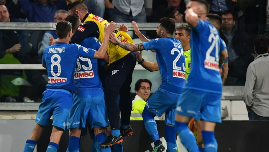 Napoli's French defender Kalidou Koulibaly celebrates with teammates after scoring a goal during the Italian Serie A football match between Juventus and Napoli on April 22, 2018 at the Allianz Stadium in Turin. (Photo by MIGUEL MEDINA / AFP)        (Photo credit should read MIGUEL MEDINA/AFP/Getty Images)