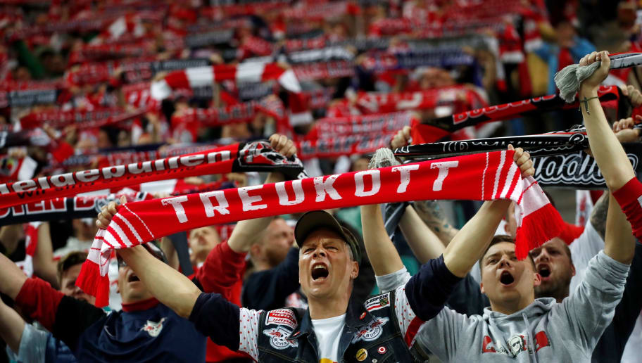 TOPSHOT - Leipzig's supporters cheer up their team during the German first division Bundesliga football match between Bayer Leverkusen vs RB Leipzig in Leipzig, eastern Germany, on April 9, 2018. / AFP PHOTO / Odd ANDERSEN / RESTRICTIONS: DURING MATCH TIME: DFL RULES TO LIMIT THE ONLINE USAGE TO 15 PICTURES PER MATCH AND FORBID IMAGE SEQUENCES TO SIMULATE VIDEO. == RESTRICTED TO EDITORIAL USE == FOR FURTHER QUERIES PLEASE CONTACT DFL DIRECTLY AT + 49 69 650050         (Photo credit should read ODD ANDERSEN/AFP/Getty Images)