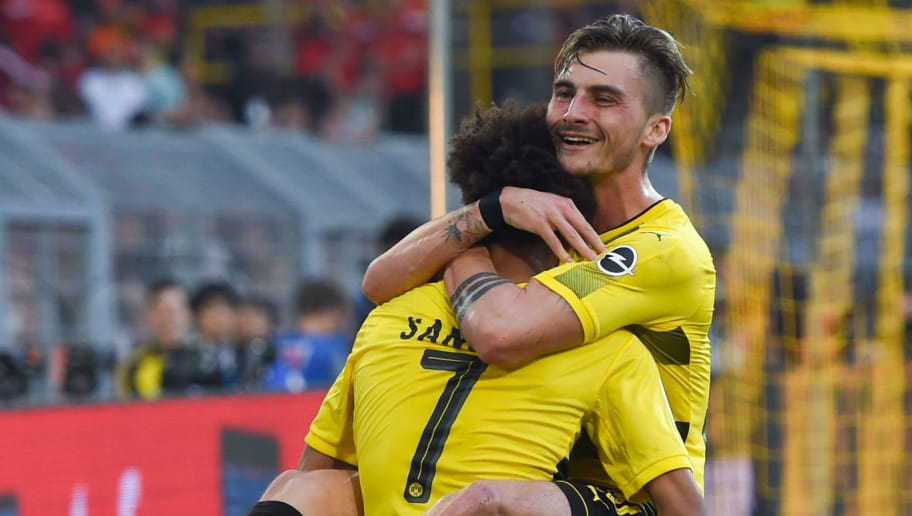 Dortmund's English midfielder Jadon Sancho (L) and Dortmund's German forward Maximilian Philipp celebrate after scoring during the German first division Bundesliga football match Borussia Dortmund vs Bayer Leverkusen, in Dortmund, western Germany, on April 21, 2018. (Photo by Patrik STOLLARZ / AFP) / RESTRICTIONS: DURING MATCH TIME: DFL RULES TO LIMIT THE ONLINE USAGE TO 15 PICTURES PER MATCH AND FORBID IMAGE SEQUENCES TO SIMULATE VIDEO. == RESTRICTED TO EDITORIAL USE == FOR FURTHER QUERIES PLEASE CONTACT DFL DIRECTLY AT + 49 69 650050        (Photo credit should read PATRIK STOLLARZ/AFP/Getty Images)