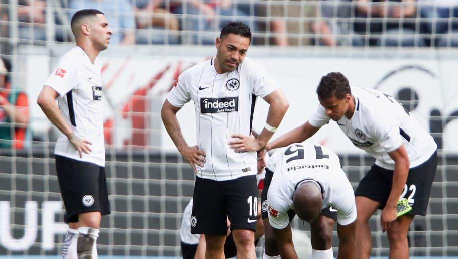 FRANKFURT AM MAIN, GERMANY - APRIL 21:  Marco Fabian #10 of Frankfurt and team mates react after the Bundesliga match between Eintracht Frankfurt and Hertha BSC at Commerzbank-Arena on April 21, 2018 in Frankfurt am Main, Germany.  (Photo by Alex Grimm/Bongarts/Getty Images)