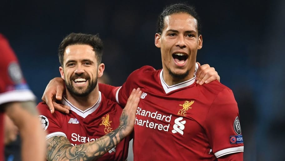 Liverpool's English striker Danny Ings (L) and Liverpool's Dutch defender Virgil van Dijk react at the final whistle the UEFA Champions League second leg quarter-final football match between Manchester City and Liverpool, at the Etihad Stadium in Manchester, north west England on April 10, 2018. Liverpool won 2-1. / AFP PHOTO / Paul ELLIS        (Photo credit should read PAUL ELLIS/AFP/Getty Images)