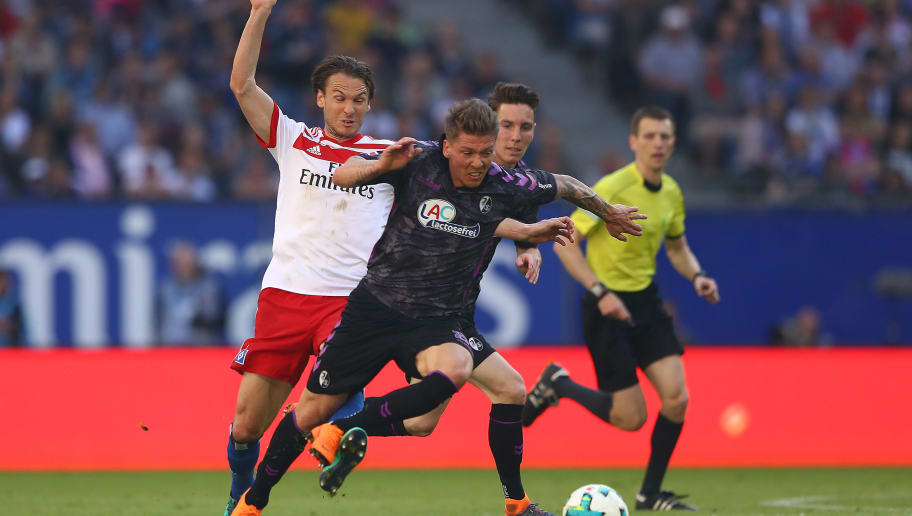 HAMBURG, GERMANY - APRIL 21: Albin Ekdal of Hamburg (l) fights for the ball with Mike Frantz of Freiburg during the Bundesliga match between Hamburger SV and Sport-Club Freiburg at Volksparkstadion on April 21, 2018 in Hamburg, Germany. (Photo by Martin Rose/Bongarts/Getty Images)