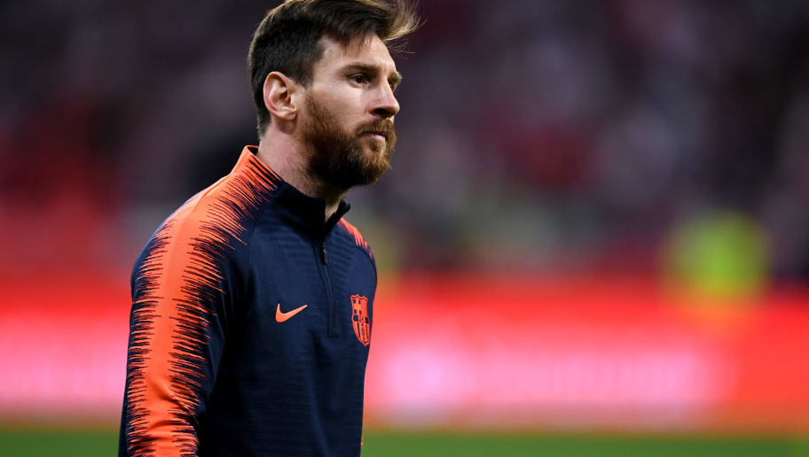 MADRID, SPAIN - APRIL 21: Barcelona's  Lionel Messi warms up ahead of the Spanish Copa del Rey Final between Barcelona and Sevilla at Wanda Metropolitano on April 21, 2018 in Madrid, Spain. (Photo by David Ramos/Getty Images)