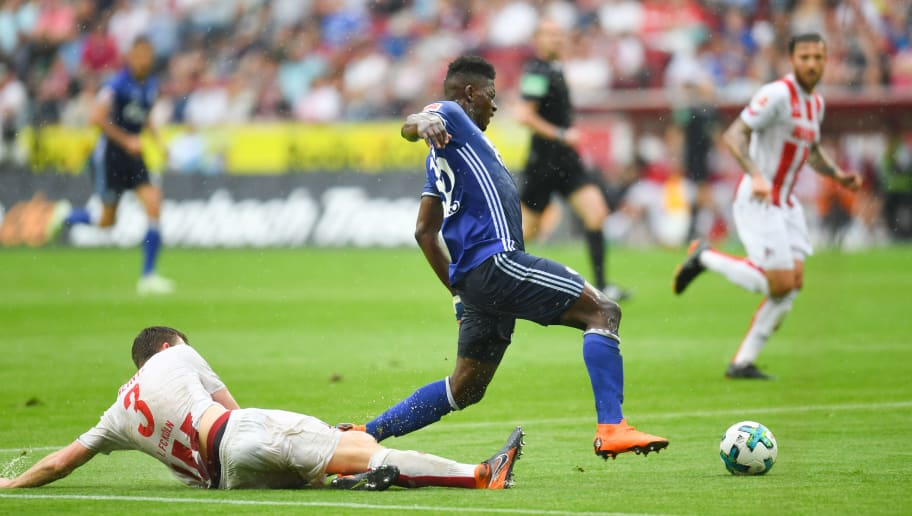 Schalke's Swiss forward Breel Embolo and Cologne's German defender Dominique Heintz vie for the ball during the German first division Bundesliga football match 1. FC Cologne vs Schalke 04, in Cologne, western Germany, on April 22, 2018. (Photo by Patrik STOLLARZ / AFP) / RESTRICTIONS: DURING MATCH TIME: DFL RULES TO LIMIT THE ONLINE USAGE TO 15 PICTURES PER MATCH AND FORBID IMAGE SEQUENCES TO SIMULATE VIDEO. == RESTRICTED TO EDITORIAL USE == FOR FURTHER QUERIES PLEASE CONTACT DFL DIRECTLY AT + 49 69 650050        (Photo credit should read PATRIK STOLLARZ/AFP/Getty Images)