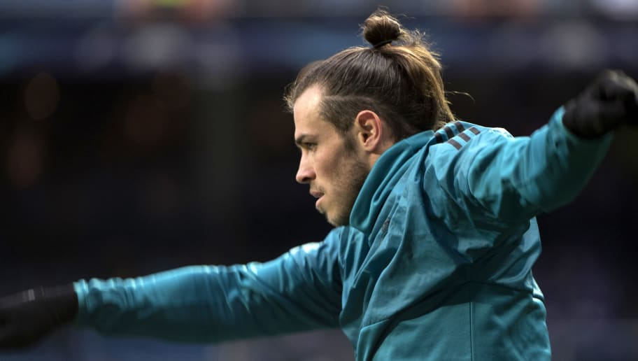 Real Madrid's Welsh forward Gareth Bale warms up before the UEFA Champions League quarter-final second leg football match between Real Madrid CF and Juventus FC at the Santiago Bernabeu stadium in Madrid on April 11, 2018. / AFP PHOTO / CURTO DE LA TORRE        (Photo credit should read CURTO DE LA TORRE/AFP/Getty Images)