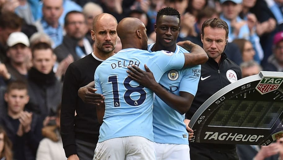 Manchester City's English midfielder Fabian Delph (L) leaves the pitch after being substituted off for Manchester City's French defender Benjamin Mendy during the English Premier League football match between Manchester City and Swansea at the Etihad Stadium in Manchester, north west England, on April 22, 2018. (Photo by Oli SCARFF / AFP) / RESTRICTED TO EDITORIAL USE. No use with unauthorized audio, video, data, fixture lists, club/league logos or 'live' services. Online in-match use limited to 75 images, no video emulation. No use in betting, games or single club/league/player publications. /         (Photo credit should read OLI SCARFF/AFP/Getty Images)