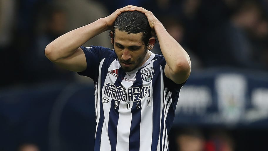 West Bromwich Albion's Egyptian defender Ahmed Hegazy reacts after the English Premier League football match between West Bromwich Albion and Swansea City at The Hawthorns stadium in West Bromwich, central England, on April 7, 2018.  / AFP PHOTO / Ian KINGTON / RESTRICTED TO EDITORIAL USE. No use with unauthorized audio, video, data, fixture lists, club/league logos or 'live' services. Online in-match use limited to 75 images, no video emulation. No use in betting, games or single club/league/player publications.  /         (Photo credit should read IAN KINGTON/AFP/Getty Images)