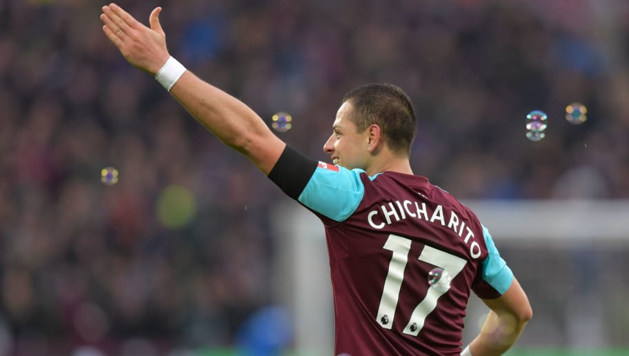 West Ham United's Mexican striker Javier Hernandez celebrates scoring the opening goal during the English Premier League football match between West Ham United and Watford at The London Stadium, in east London on February 10, 2018. / AFP PHOTO / OLLY GREENWOOD / RESTRICTED TO EDITORIAL USE. No use with unauthorized audio, video, data, fixture lists, club/league logos or 'live' services. Online in-match use limited to 75 images, no video emulation. No use in betting, games or single club/league/player publications.  /         (Photo credit should read OLLY GREENWOOD/AFP/Getty Images)