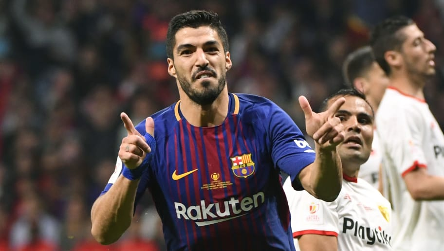 Barcelona's Uruguayan forward Luis Suarez (L) celebrates after scoring his second goal during the Spanish Copa del Rey (King's Cup) final football match Sevilla FC against FC Barcelona at the Wanda Metropolitano stadium in Madrid on April 21, 2018. (Photo by PIERRE-PHILIPPE MARCOU / AFP)        (Photo credit should read PIERRE-PHILIPPE MARCOU/AFP/Getty Images)