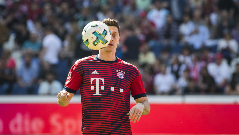 Bayern Munich's Polish forward Robert Lewandowski warms up prior to the German first division Bundesliga football match between Hannover 96 vs Bayern Munich in Hanover, central Germany, on April 21, 2018. (Photo by ODD ANDERSEN / AFP) / RESTRICTIONS: DURING MATCH TIME: DFL RULES TO LIMIT THE ONLINE USAGE TO 15 PICTURES PER MATCH AND FORBID IMAGE SEQUENCES TO SIMULATE VIDEO. == RESTRICTED TO EDITORIAL USE == FOR FURTHER QUERIES PLEASE CONTACT DFL DIRECTLY AT + 49 69 650050        (Photo credit should read ODD ANDERSEN/AFP/Getty Images)