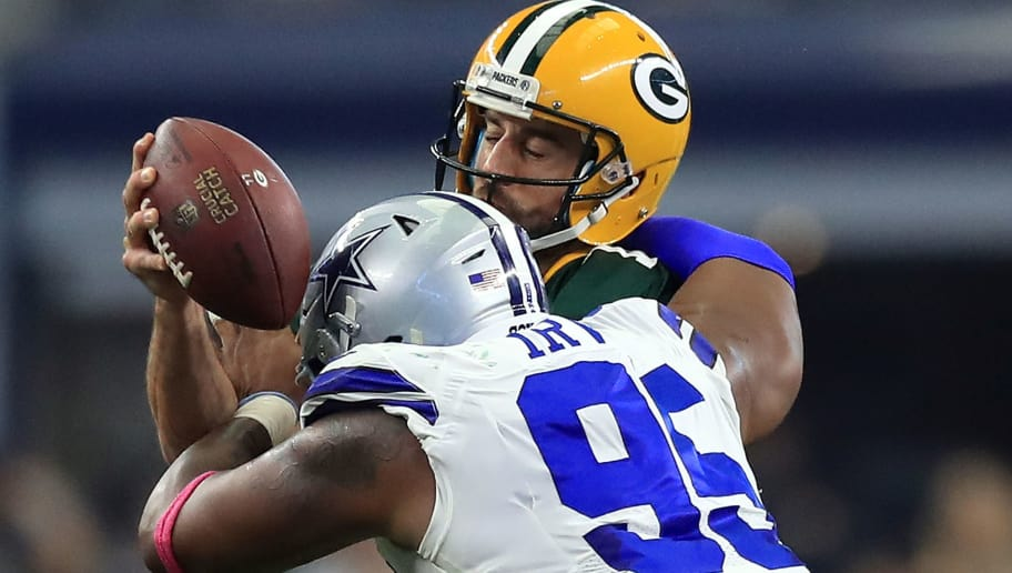 ARLINGTON, TX - OCTOBER 08:  Aaron Rodgers #12 of the Green Bay Packers is sacked by David Irving #95 of the Dallas Cowboys in the second quarter at AT&T Stadium on October 8, 2017 in Arlington, Texas.  (Photo by Ronald Martinez/Getty Images)