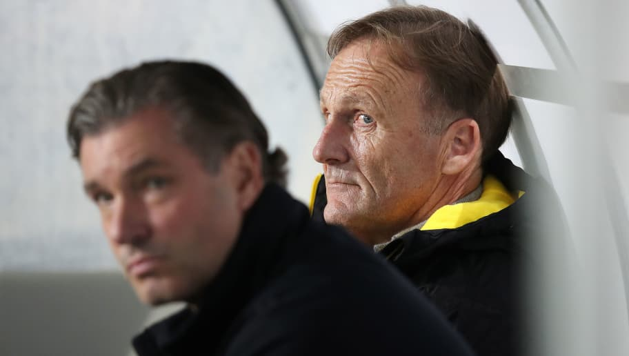 MAGDEBURG, GERMANY - OCTOBER 24: Hans-Joachim Watzke (R), CEO of Dortmund, and sporting director Michael Zorc (L) of Dortmund look on prior to the DFB Cup match between 1. FC Magdeburg and Borussia Dortmund at MDCC-Arena on October 24, 2017 in Magdeburg, Germany. (Photo by Ronny Hartmann/Bongarts/Getty Images)