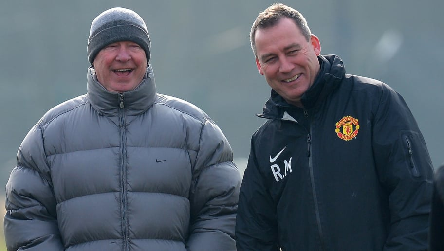 Manchester United manager Alex Ferguson (L) laughs with first team coach Rene Meulensteen during a training session at the Carrington training complex  in Manchester, north-west England on March 4, 2013, on the eve of their UEFA Champions League first knockout round second leg football match against Real Madid. AFP PHOTO/ANDREW YATES.        (Photo credit should read ANDREW YATES/AFP/Getty Images)