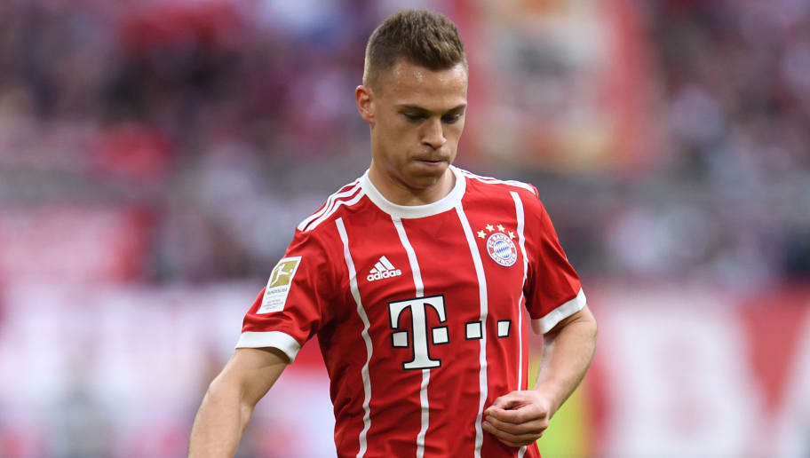 Bayern Munich's German midfielder Joshua Kimmich plays the ball during the German first division Bundesliga football match FC Bayern Munich vs Borussia Moenchengladbach in Munich, southern Germany, on April 14, 2018. / AFP PHOTO / Christof STACHE / RESTRICTIONS: DURING MATCH TIME: DFL RULES TO LIMIT THE ONLINE USAGE TO 15 PICTURES PER MATCH AND FORBID IMAGE SEQUENCES TO SIMULATE VIDEO. == RESTRICTED TO EDITORIAL USE == FOR FURTHER QUERIES PLEASE CONTACT DFL DIRECTLY AT + 49 69 650050  / RESTRICTIONS: DURING MATCH TIME: DFL RULES TO LIMIT THE ONLINE USAGE TO 15 PICTURES PER MATCH AND FORBID IMAGE SEQUENCES TO SIMULATE VIDEO. == RESTRICTED TO EDITORIAL USE == FOR FURTHER QUERIES PLEASE CONTACT DFL DIRECTLY AT + 49 69 650050        (Photo credit should read CHRISTOF STACHE/AFP/Getty Images)