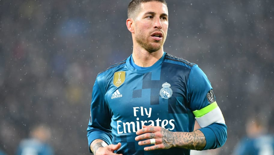 Real Madrid's Spanish defender Sergio Ramos looks on during the UEFA Champions League quarter-final first leg football match between Juventus and Real Madrid at the Allianz Stadium in Turin on April 3, 2018. / AFP PHOTO / Alberto PIZZOLI        (Photo credit should read ALBERTO PIZZOLI/AFP/Getty Images)