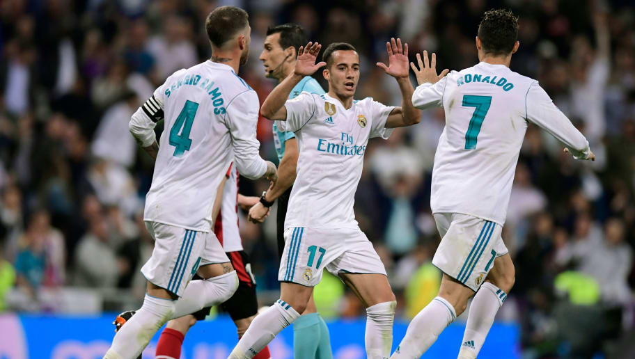 Real Madrid's Portuguese forward Cristiano Ronaldo (R) celebrates with Real Madrid's Spanish midfielder Lucas Vazquez after scoring during the Spanish league football match Real Madrid CF against Athletic Club Bilbao at the Santiago Bernabeu stadium in adrid on April 18, 2018. / AFP PHOTO / JAVIER SORIANO        (Photo credit should read JAVIER SORIANO/AFP/Getty Images)