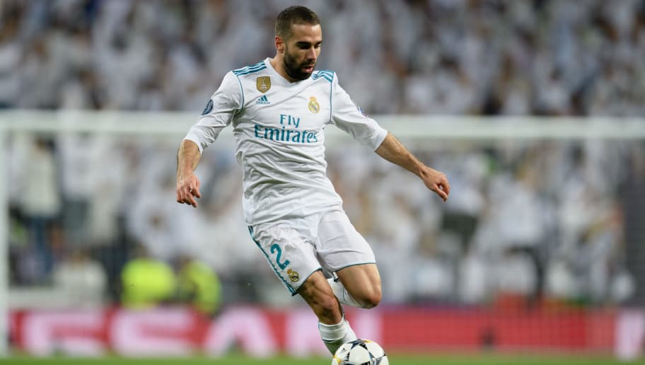 MADRID, SPAIN - APRIL 11: Dani Carvajal of Real Madrid controls the ball during the UEFA Champions League Quarter Final Second Leg match between Real Madrid and Juventus at Estadio Santiago Bernabeu on April 11, 2018 in Madrid, Spain. (Photo by Matthias Hangst/Bongarts/Getty Images)