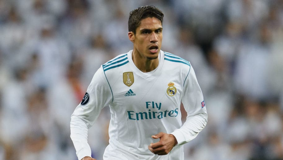 MADRID, SPAIN - APRIL 11: Raphael Varane of Real Madrid controls the ball during the UEFA Champions League Quarter Final Second Leg match between Real Madrid and Juventus at Estadio Santiago Bernabeu on April 11, 2018 in Madrid, Spain. (Photo by Matthias Hangst/Bongarts/Getty Images)