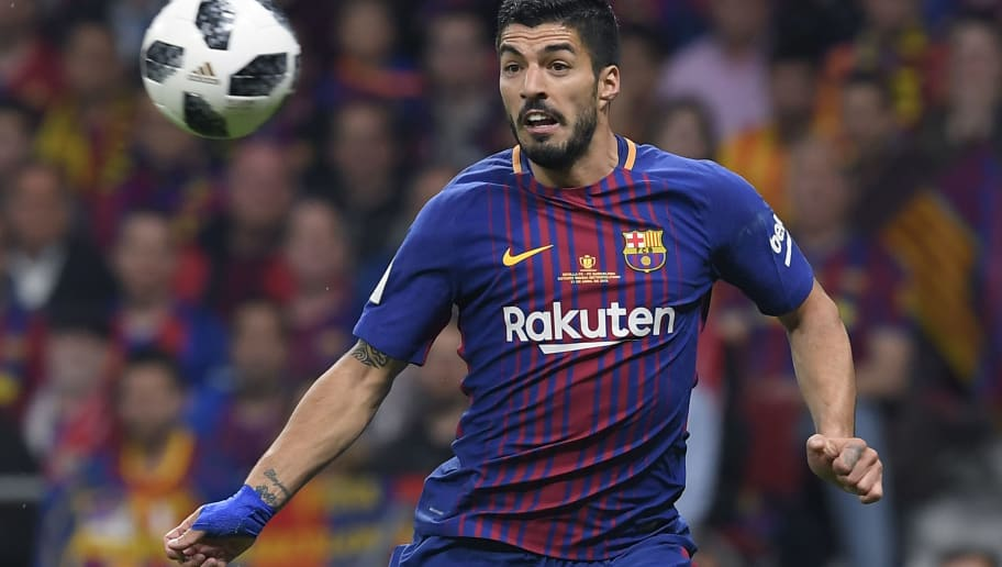 Barcelona's Uruguayan forward Luis Suarez eyes the ball during the Spanish Copa del Rey (King's Cup) final football match Sevilla FC against FC Barcelona at the Wanda Metropolitano stadium in Madrid on April 21, 2018. (Photo by LLUIS GENE / AFP)        (Photo credit should read LLUIS GENE/AFP/Getty Images)