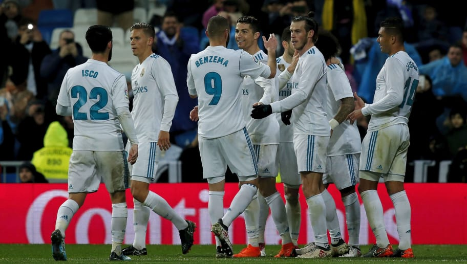 MADRID, SPAIN - MARCH 03: Cristiano Ronaldo (4thL) of Real Madrid CF celebrates scoring their third goal with teammates Karim Benzema (2ndL)  and Gareth Bale (5thL) during the La Liga match between Real Madrid CF and Getafe CF at Estadio Santiago Bernabeu on March 3, 2018 in Madrid, Spain. (Photo by Gonzalo Arroyo Moreno/Getty Images)